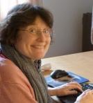 Carolyn at her desk