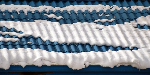blue tile roof with bands of snow