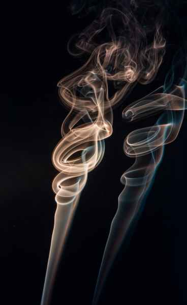 Image of smoke rising in a vortex